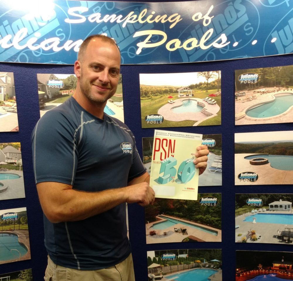 This is a photo of brian juliano with the top 50 pool builders award.