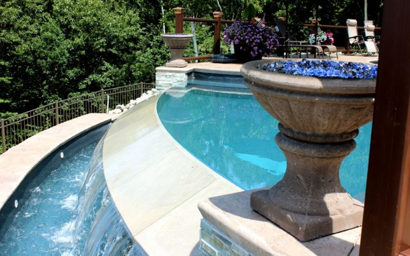 This Is A Close Up Photo Of A Custom Pool With Overflow Waterfall Installed By Julianos