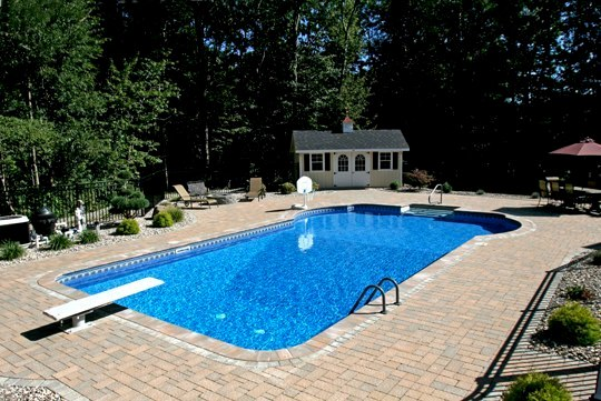 This Is A Photo Of A Custom Pool Installed By Julianos With Diving Board, Gate, And Small House Built Poolside