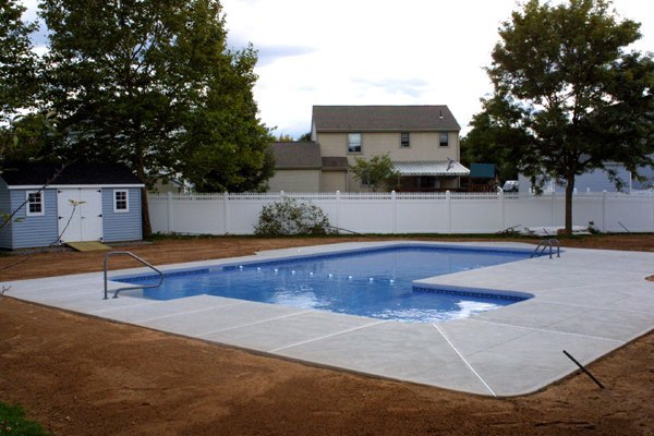 This Is A Side View Photo Of A Custom L-shaped Pool Installed By Julianos
