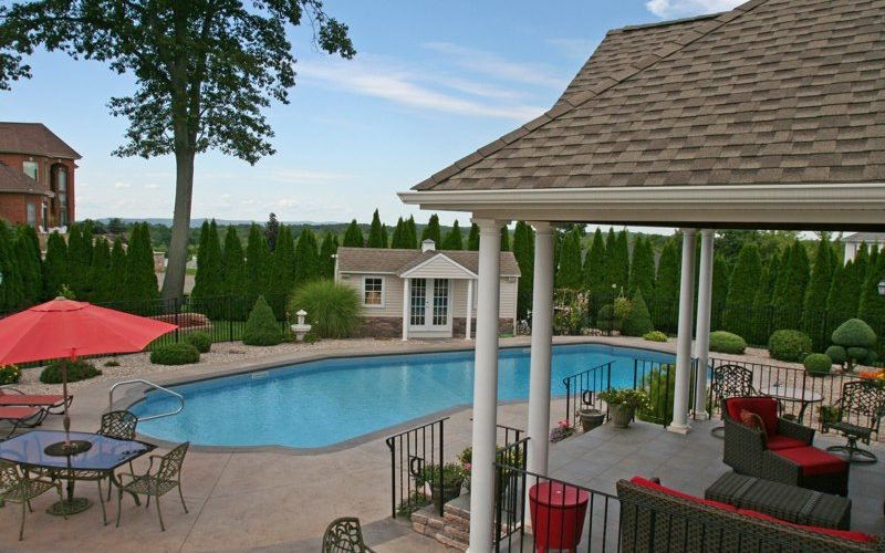 This Is A Photo Of A Lazy L Style Custom Inground Swimming Pool With Custom Pool House