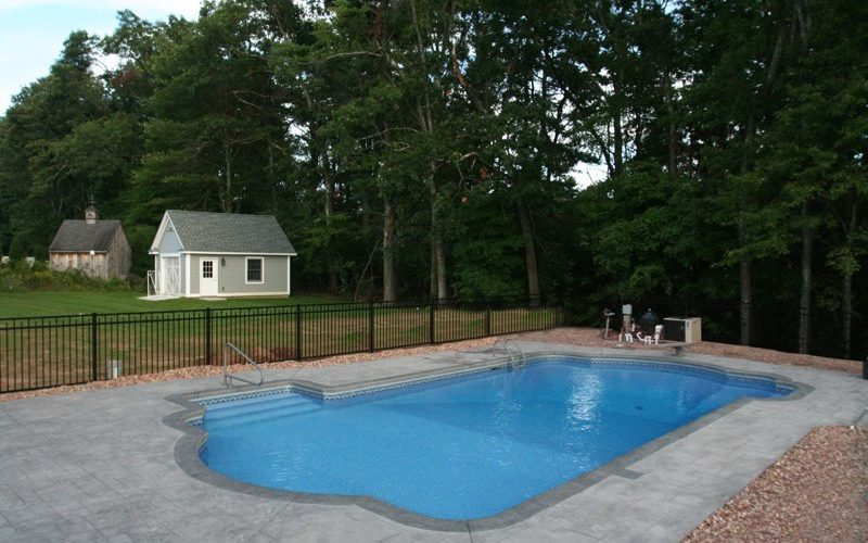 This Is A Photo Of A Roman In Ground Pool In East Longmeadow, MA With Custom Pavers, Diving Board And Steps.
