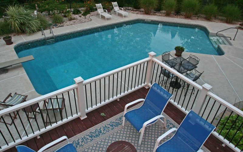 This Is A Photo Of A Lazy L Style Custom Inground Swimming Pool Overlooking From The Deck.
