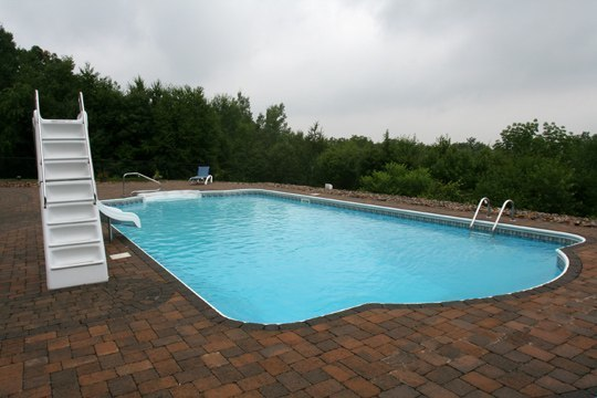 This Is A Photo Of A Roman In Ground Pool In Somers, CT With Custom Pavers And Steps.