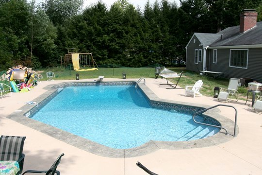 This Is A Photo Of A Lazy L Style Custom Inground Swimming Pool With Steps.