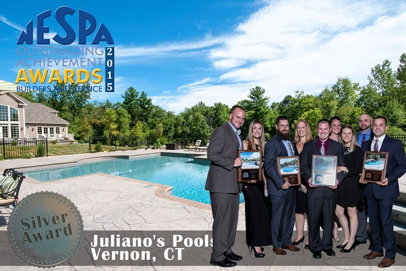 This is a picture of Julianao's Pools being awarded the NESPA outstanding achievement award