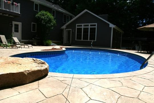 This is a kidney shape new pool construction in Lebanon, CT