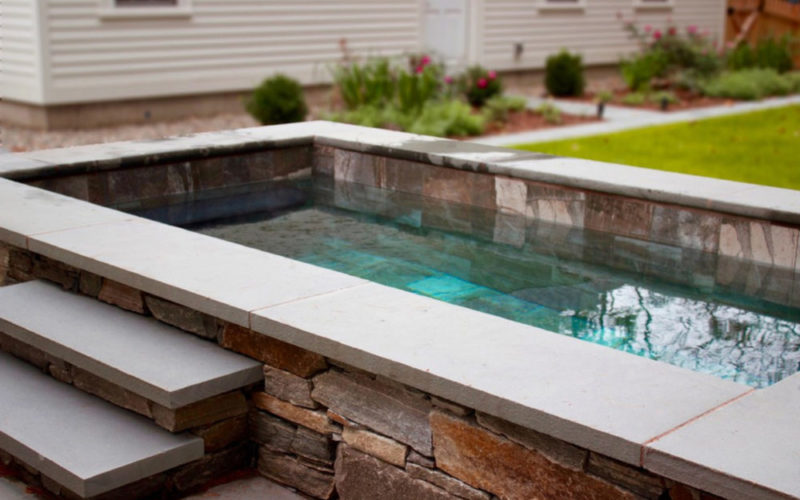 This Is A Close Up Photo Of A Stone Soake Pool.